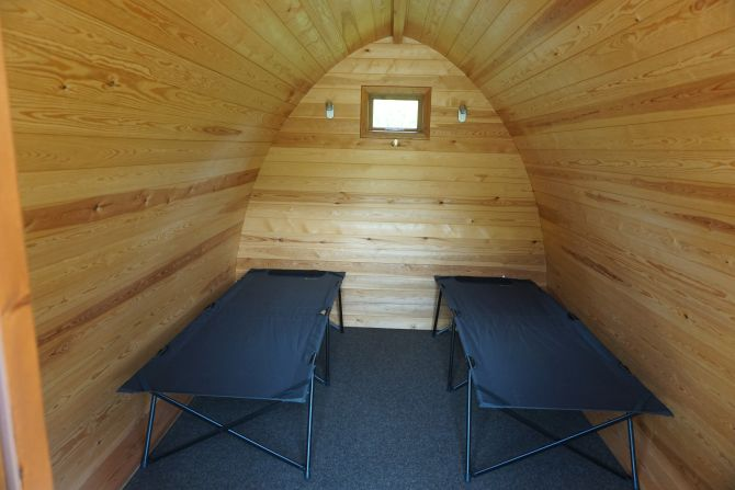 Interior shot of a camping Pod at Woodland Springs Touring Park showing the camp beds