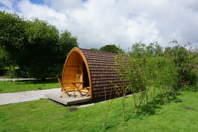 A Camping Pod and its pitch at Woodland Springs